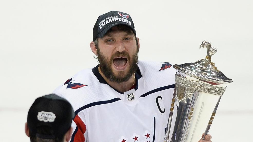 Washington Capitals right wing Tom Wilson (43) watches as left wing Alex  Ovechkin celebrates while holding the Prince of Wales trophy after the  Capitals ... 4ad620cbc73c