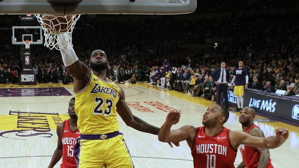 0d9801e2d Los Angeles Lakers  LeBron James (23) dunks past Houston Rockets  Eric  Gordon (10) during the second half of an NBA basketball game Thursday