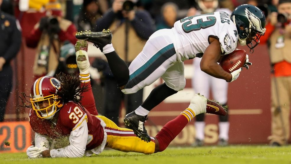 Philadelphia Eagles running back Darren Sproles (43) is kicked off his feet  by Washington Redskins defensive back Adonis Alexander (39) during the  first ... 973f9a15c