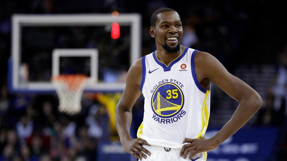 a2a31467399d Golden State Warriors  Kevin Durant smiles during a break in play during  the second half of an NBA basketball game against the Dallas Mavericks  Thursday