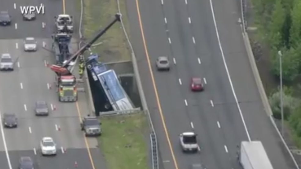 Watch: A truck is dangling from I-195 after an accident in New