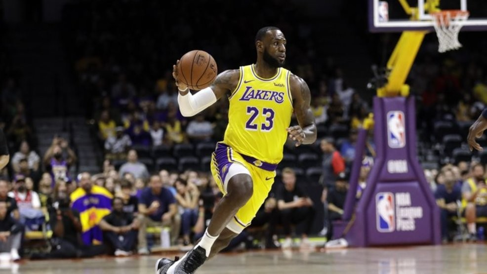 ec47ee80758b Los Angeles Lakers forward LeBron James dribbles during the first half of  an NBA preseason basketball game against the Denver Nuggets