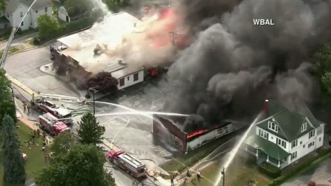 Officials: Firefighters battle massive building fire in Mt