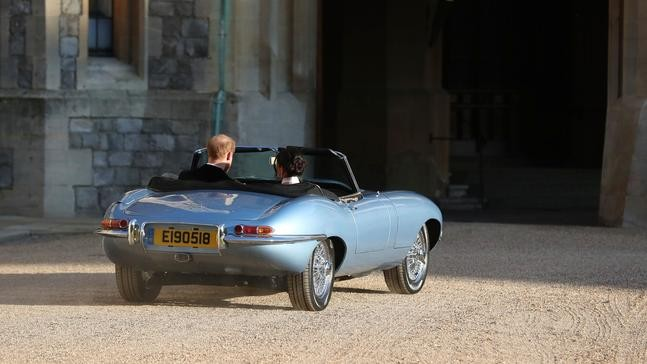 what a ride! newlyweds drives off in classic jaguar after the royal