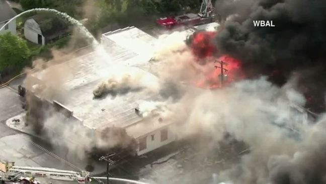 Officials: Firefighters battle massive building fire in Mt  Airy, no