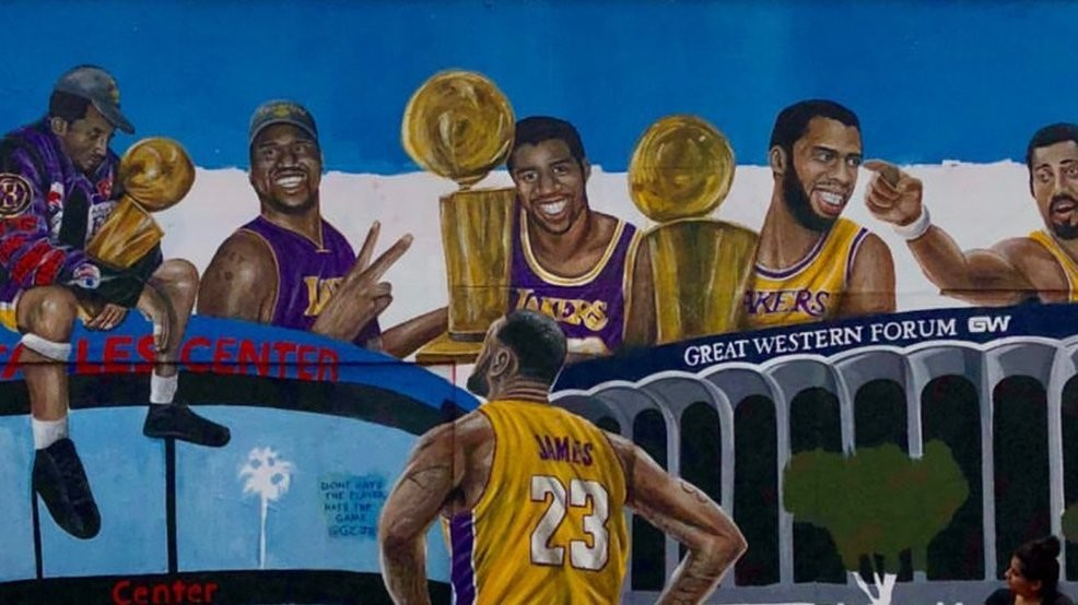 68e07951136c A new mural features LeBron James looking up at former Los Angeles Lakers  greats. Thursday