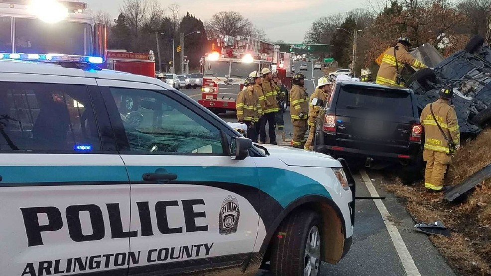 Car overturns leaving 1 person trapped inside vehicle in Arlington